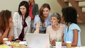 Smiling women working together
