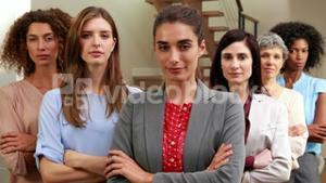Serious women standing with arms crossed