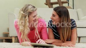 Happy women using tablet