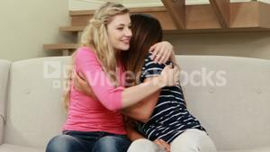 Blonde comforting her crying friend