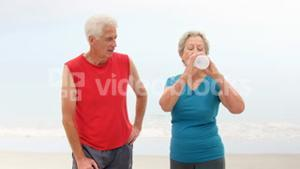 Old couple drinking water