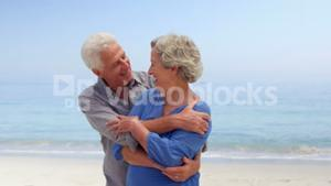 Old couple hugging and dancing