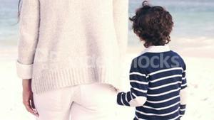 Mother and son looking at the sea