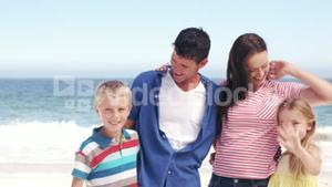 Cute family saying goodbye to camera