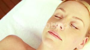 Relaxed blonde with closed eyes