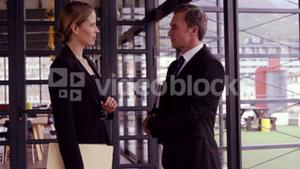 Businessman and businesswoman talking together