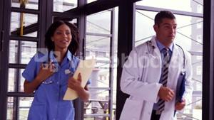 Doctor and nurse running together