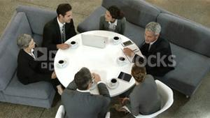 Business people sitting in circle