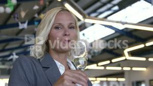 Smiling businesswoman drinking champagne
