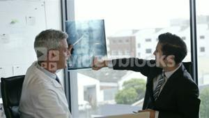 Doctors and businessman looking at scans