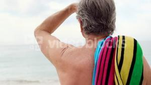 Retired man looking away on the beach