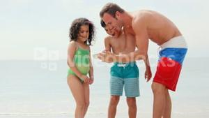 Father showing pictures to children