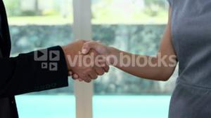 Man and woman shake hands