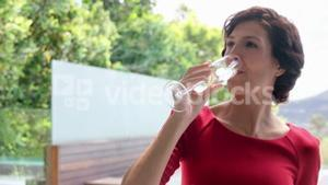 Woman drinking champagne outside
