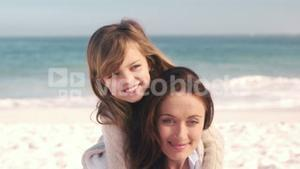 Young smiling mother with her daughter