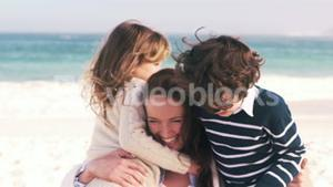 Young smiling mother with her children