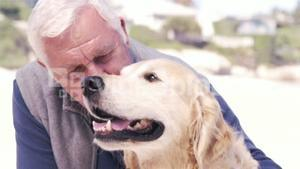 Old retired man embracing his dog