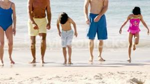 Cute family standing on the beach