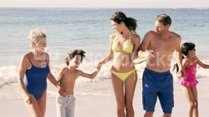 Cute family dancing on the beach