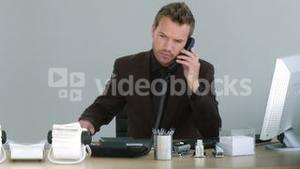 Businessman working on his desk with a phone