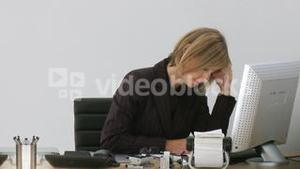 Businesswoman frustrated at her computer crashing