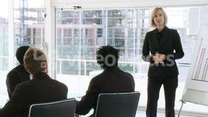 Businesswoman explaining business results to her team