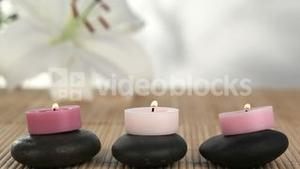 Candles raised on black stones