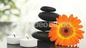 Black stones, candles and sunflower