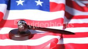 Gavel raised on an American flag