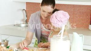 Mother and daughter in home Kitchen