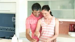 Young happy couple in the kitchen