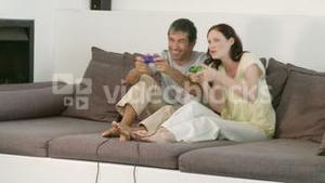 Happy couple playing a video game