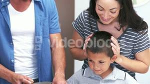 Cute family slicing vegetables in the kitchen