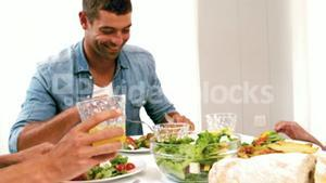 Cute family having lunch on the table