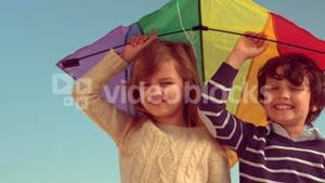 Happy childs playing with kite