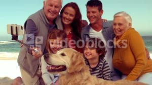 Happy extended family smiling with dog