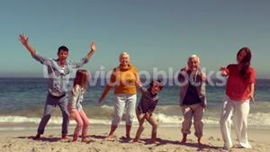 Happy family jumping with hands up