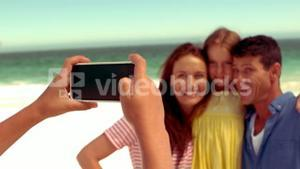 Happy family taking pictures