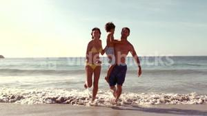 Happy family running in water