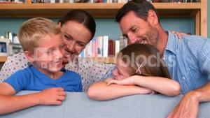 Smiling family talking together