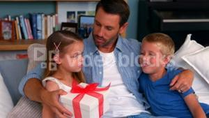 Father giving present to daughter