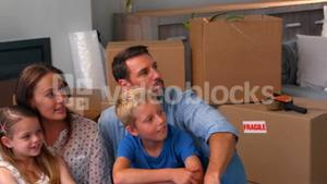 Family relaxing while moving house