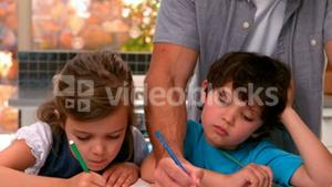 Father and children drawing together
