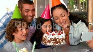 Family celebrating birthday together