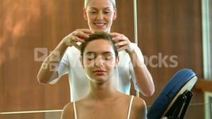 Relaxed woman getting a head massage