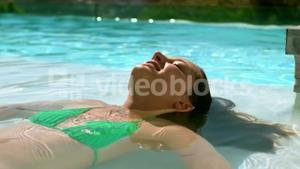 Pretty woman floating in the pool