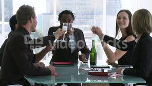 Business team celebrating success with champagne