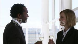 Two business people toasting their success