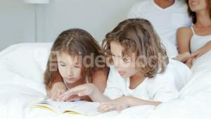 Children reading while parents talking