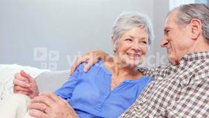 Cute elderly couple talking